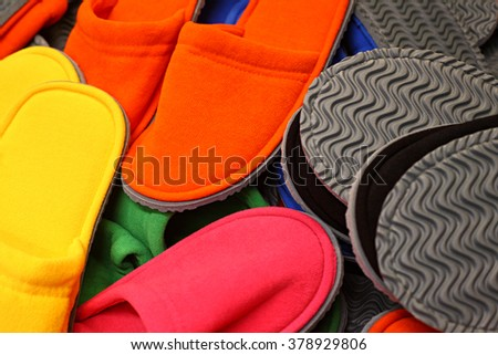 Heap of slippers of different colors