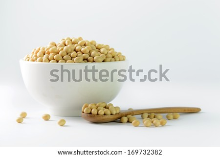 Heap of soya beans on bowl on white background - stock photo