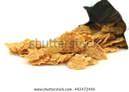 heap of sugar-coated corn flakes isolated on white - stock photo