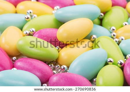 heap of sugared almonds and silver dragees - stock photo