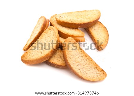 heap of sweet crackers on white closeup - stock photo