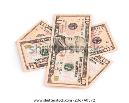 Heap of ten bill dollars. Isolated on a white background. - stock photo