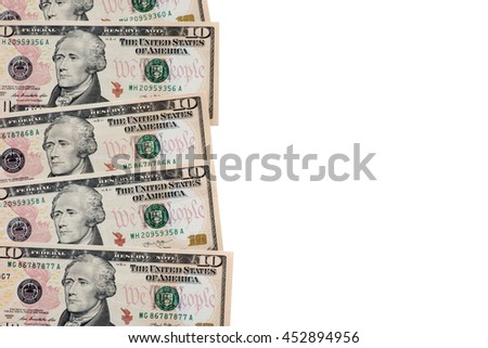 Heap of ten US dollar banknotes with text space. - stock photo