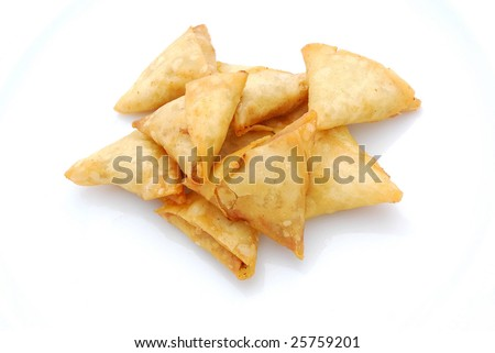Heap of traditional South African Samoosa triangle pockets filled with chicken and beef mince isolated on white studio background. - stock photo