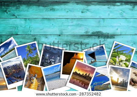 heap of travel photos on azure wood background - stock photo