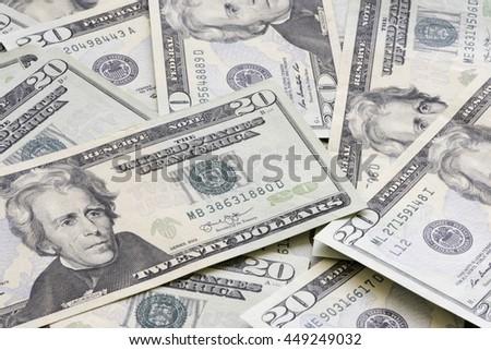 Heap of twenty US dollar banknotes. - stock photo