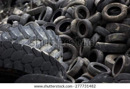 Heap of used tyre outdoor - stock photo