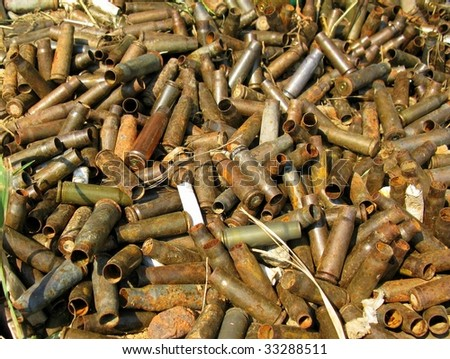 Heap of very old empty bullet shells - stock photo