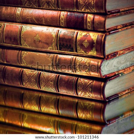 Heap of vintage books with golden touch - stock photo