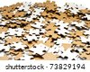 heap of white and brown puzzle pieces - stock photo
