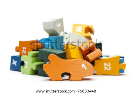 heap of wooden puzzle blocks - stock photo