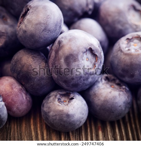 heap ripe sweet blueberries on wooden table - stock photo