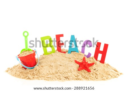 heap sand with beach items and word for vacation - stock photo