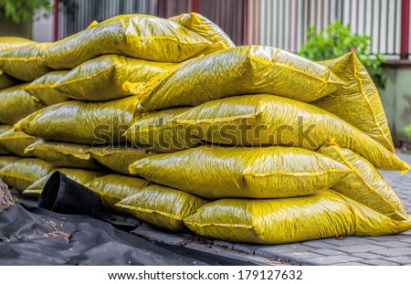 Heap with bags full of garden bark - stock photo