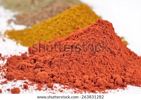 Heaps of different dry spices on a white background - stock photo