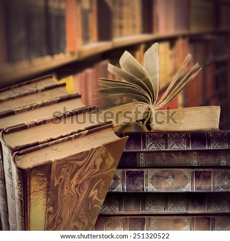heaps of vintage books in library or book store - stock photo