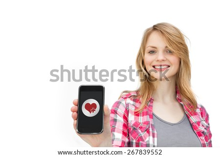 heart against woman showing a mobile phone - stock photo