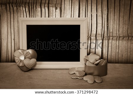 heart and blackboard with old bamboo wall background
