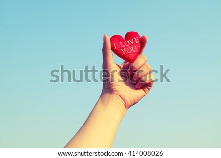 heart and hand .Vintage Style - stock photo