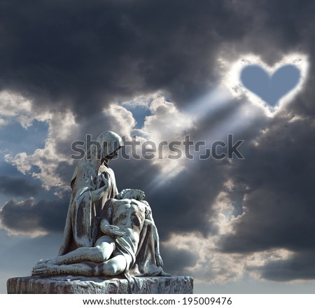 Heart and Jesus Christ - heart in the clouds illuminating the tombstone, representing the Virgin Mary, holding the body of Jesus Christ. Vysehrad Cemetery in Prague, Czech Republic. Religious art. - stock photo