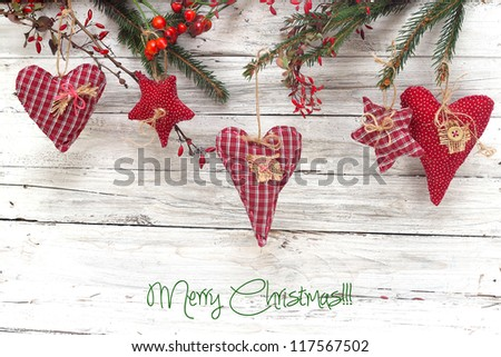 heart and  red stars on wooden background - stock photo