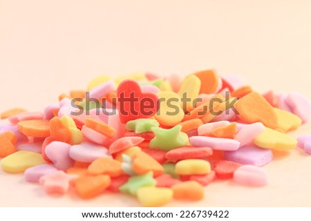 Heart and star shaped colorful sugar - stock photo