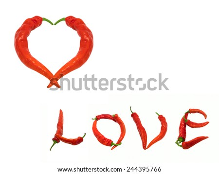 Heart and word Love composed of red chili peppers. Isolated on white background. - stock photo