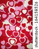 Heart background for Valentine's day made with pink and red hearts - stock photo
