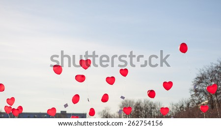 Heart balloons in front of blue sky