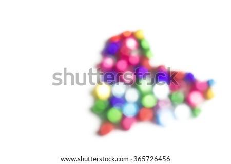 Heart blur Bokeh on white background. - stock photo