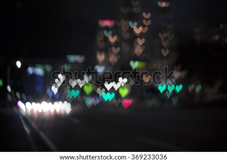 Heart bokeh background. Valentine's day background in the night  city. Love in the city, in the air. - stock photo