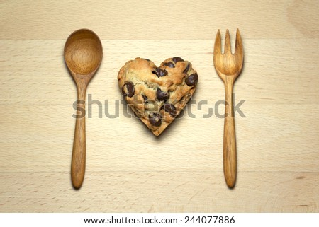 Heart chocolate chip cookie on wood table - stock photo