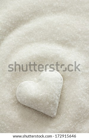 Heart covered in white sugar - stock photo