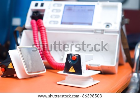 Heart Defibrillator - emergency high technology equipment - stock photo