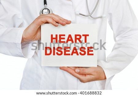 Heart Disease card in hands of Medical Doctor - stock photo
