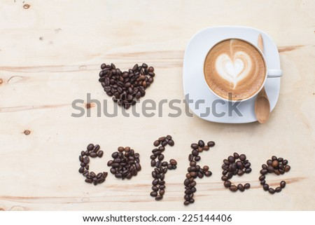 Heart drawing on latte art coffee cup - stock photo