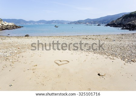 Heart drawn in the beach - stock photo