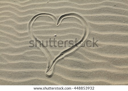 Heart drawn in the sand. Beach background. Top view - stock photo