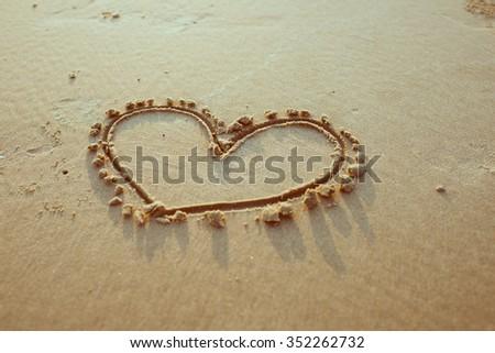 Heart drawn on sand. Horizontal composition. - stock photo