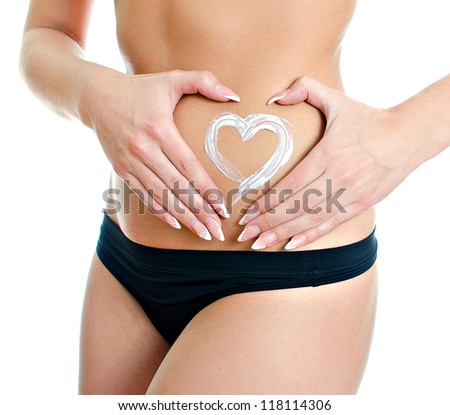 Heart drawn with cream on female stomach. Isolated on white - stock photo
