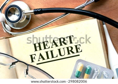 Heart failure concept. Books with stethoscope and. - stock photo