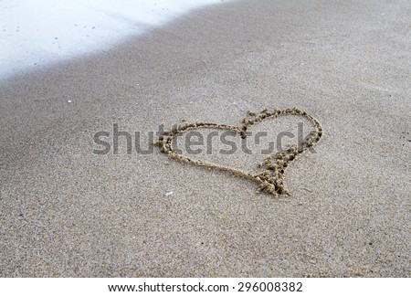 Heart figure sand - stock photo