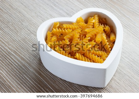 Heart filled with gluten free fusilli pasta.
