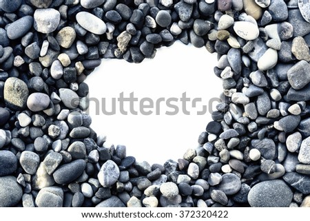 Heart form frame of colored sea stones - stock photo