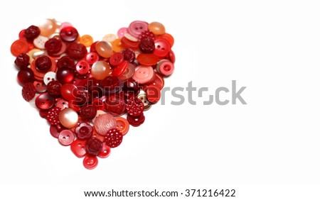 Heart formed from red and pink buttons. Sewing buttons heart - stock photo
