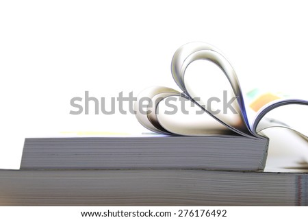 Heart from book pages - stock photo