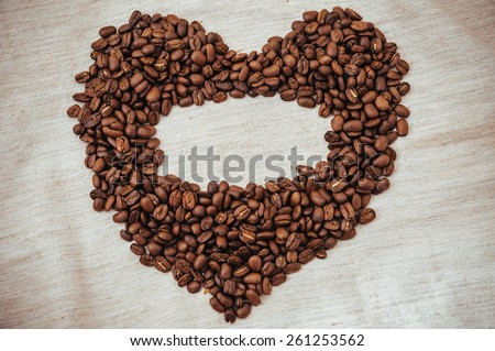 Heart from Coffe beans. Coffee beans in shape of heart. coffee beans isolated on white background. roasted coffee beans, can be used as a background. - stock photo