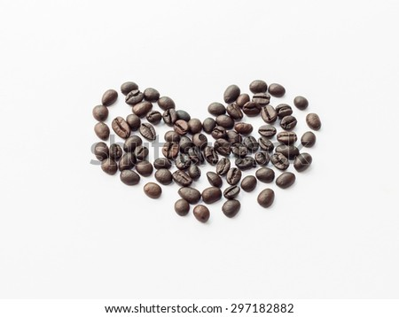 Heart from coffee beans, isolated on white - stock photo