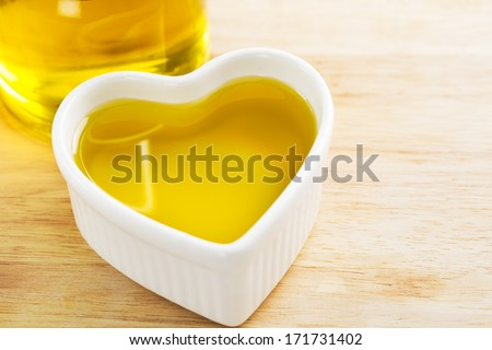 Heart full of healthy olive oil. - stock photo