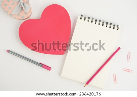 Heart gift box and note book pen on  white background - stock photo